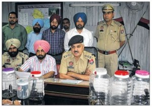 Fatehgarh Sahib SSP Gurmit Singh Chauhan along with other police officers addressing the media persons at Fatehgarh Sahib [September 06, 2013]