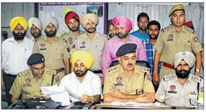 SSP Gurmit Singh Chauhan along with other officers addressing a press conference at Fatehgarh Shaib on September 16, 2013