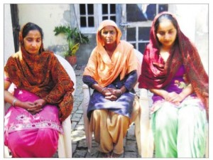 Gurdeep Singh's wife Harvinder Kaur (left) and daughter Prabhjot Kaur (right) at their home in Fatehgarh Sahib's Alampur village on Wednesday (March 19).